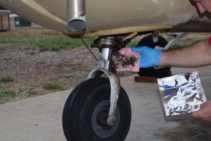 Strutwipe: K&M Industry's Revolutionary Pre-saturated Hydraulic Wipe is Convenient, Keeps Your Aircraft Clean