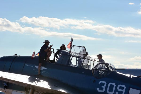 Visitors check out a Commemorative Air Force Avenger