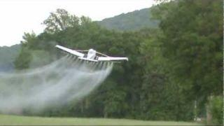 CROP DUSTING--CESSNA  A188 AG WAGON / AIG AIR TRACTOR AT WORK.wmv